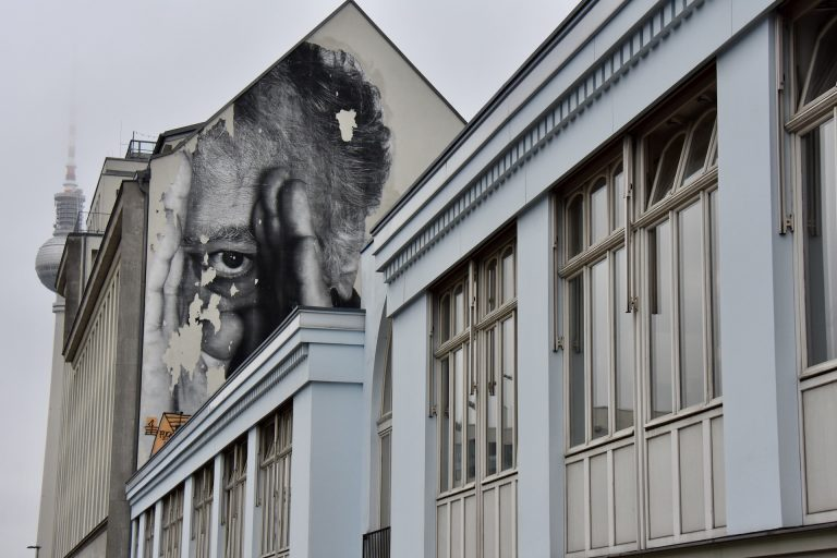 street art face on house in berlin